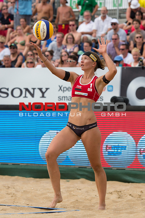19.07.2014, Den Haag, Beach Stadion Scheveningen<br /> FIVB Transavia Grand Slam, Halbfinale<br /> <br /> Aufschlag / Service Katrin Holtwick (#1 GER)<br /> <br />   Foto &copy; nordphoto / Kurth
