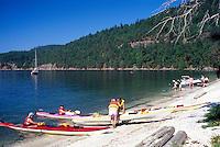 Galiano Island, Southern Gulf Islands, BC, British Columbia, Canada - Kayakers preparing for Ocean Kayak Trip at Montague Harbour Provincial Marine Park, Summer