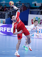 Egypt's Ahmed Mostafa (l) and Spain's Victor Tomas Gonzalez during 23rd Men's Handball World Championship preliminary round match.January 14,2013. (ALTERPHOTOS/Acero) /NortePhoto