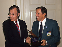 Washington DC., USA,  1989<br /> President George H.W. Bush is presented with the Bass Fisherman of the year award in the Oval Office. Credit: Mark Reinstein/MediaPunch