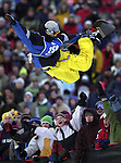 Snowboarder Todd Richards of Encinitas, Calif. is cheered by the crowd while competing in the Snowboarding Superpipe final during the Winter X Games at Mount Snow, Vermont on Saturday, February 5, 2000. Richards won the event. STAFF PHOTO BY CHRISTOPHER EVANS.