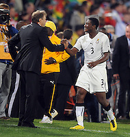 Asamoah Gyan of Ghana is congratulated by manager Milovan Rajevac after being substituted following his winning goal