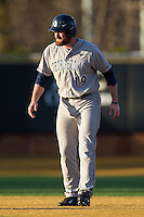 Steve Anderson (19) of the Georgetown Hoyas takes his lead off of second base against the Wake Forest Demon Deacons at Wake Forest Baseball Park on February 16, 2014 in Winston-Salem, North Carolina.  The Demon Deacons defeated the Hoyas 3-2.  (Brian Westerholt/Four Seam Images)