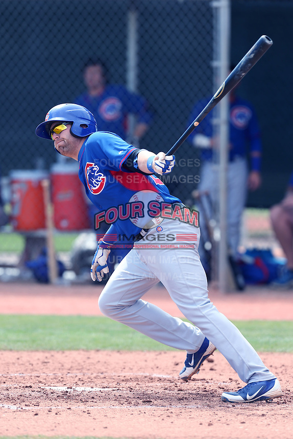 Dustin Geiger of the Chicago Cubs bats during a Minor League Spring Training Game against the Los Angeles Angels at the Los Angeles Angels Spring Training Complex on March 23, 2014 in Tempe, Arizona. (Larry Goren/Four Seam Images)