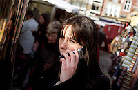 A young woman phoning with her mobile phone (Belgium, 05/11/2004)