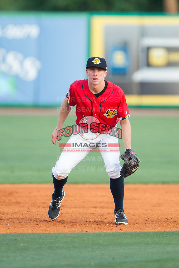 Charleston RiverDogs third baseman John Murphy (3) on defense against the Greenville Drive at Joseph P. Riley, Jr. Park on May 26, 2014 in Charleston, South Carolina.  The Drive defeated the RiverDogs 11-3.  (Brian Westerholt/Four Seam Images)
