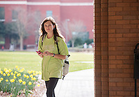 Students walking past McCool daffodils.<br />