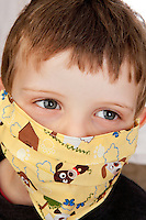 Little Boy with fun medical mask with puppy desing