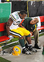 Aug. 28, 2009; Glendale, AZ, USA; Green Bay Packers running back (32) Brandon Jackson is tended to by a trainer after suffering an injury against the Arizona Cardinals during a preseason game at University of Phoenix Stadium. Mandatory Credit: Mark J. Rebilas-