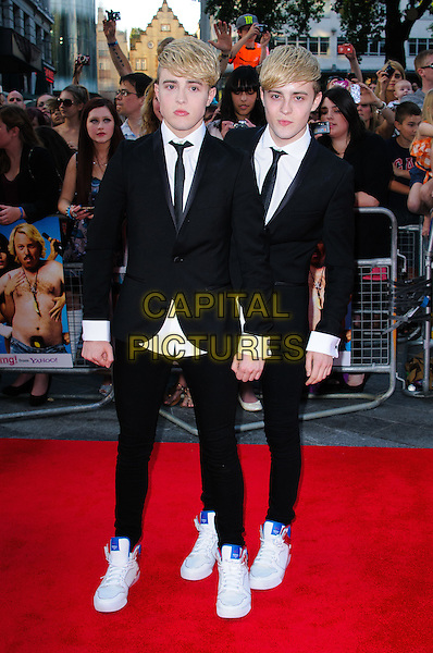 Jedward (John & Edward Grimes).The World Premiere of 'Keith Lemon: The Film', Odeon West End, London, England..20th August 2012.full length black suit white shirt brothers twins siblings .CAP/CJ.©Chris Joseph/Capital Pictures.