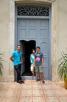 Pamela and Damian Aquiles with their son Bastian Nicolas at the entrance to their Havana home