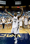 March 1, 2012: Nevada Wolf Pack guard Dario Hunt celebrates by cutting down the net after the game against the  New Mexico State Aggies played at Lawlor Events Center on Thursday night in Reno, Nevada. Nevada (24-5, 12-1 WAC) won its fourth outright Western Athletic Conference title after defeating New Mexico State (22-9, 9-4 WAC) 65-61.