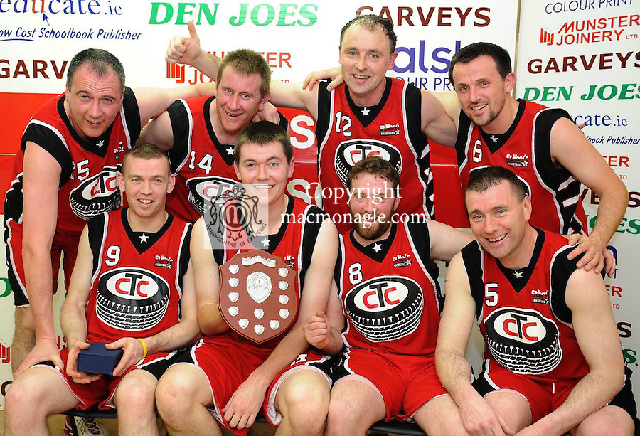 30-12-11: St. Marys Castleisland celebrate after defeating Euro All Stars  in the  division one mens  final at the St. Marys Basketball Club annual blitz in Castleisland Community Centre on Friday night.  Front from left are Neilus Lyons, Donal McCarthy, Tom O'Regan and Tom Fleming. Back from left are Maurice Casey, Brian Clernon, John Teahan and Ruairi O'Rahilly. Picture: Eamonn Keogh (MacMonagle, Killarney)