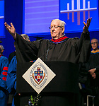 The Rev. Paul Sisul, C.M., senior professional lecturer, offers an invocation Sunday, June 11, 2017, during the DePaul University College of Computing and Digital Media and the College of Communication commencement ceremony at the Allstate Arena in Rosemont, IL. (DePaul University/Jamie Moncrief)