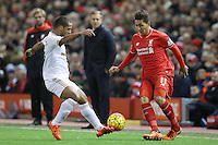 Wayne Routledge competes with Roberto Firmino during the Barclays Premier League Match between Liverpool and Swansea City played at Anfield, Liverpool on 29th November 2015