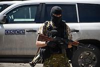 Pro-Russian rebel guarding the OSCE car in Torez. Eastern Ukraine