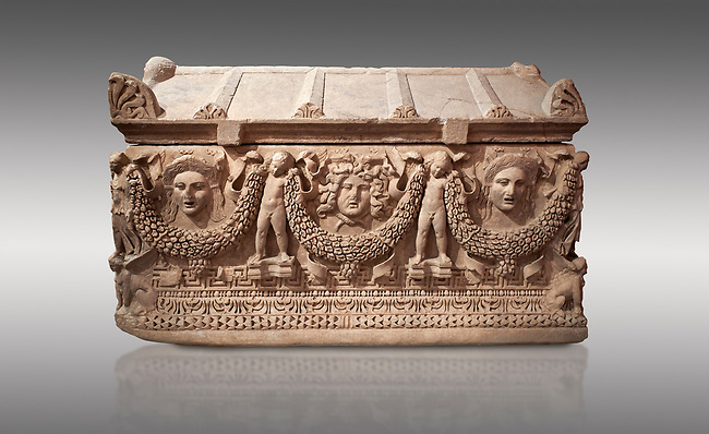 """Picture of Roman relief sculpted Sarcophagus of Garlands, 2nd century AD, Perge. This type of sarcophagus is described as a """"Pamphylia Type Sarcophagus"""". It is known that these sarcophagi garlanded tombs originated in Perge and manufactured in the sculptural workshops of Perge. Antalya Archaeology Museum, Turkey.. Against a grey background."""