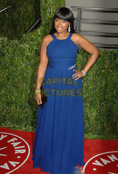 JENNIFER HUDSON.The 2010 Vanity Fair Oscar Party held at The Sunset Tower Hotel in West Hollywood, California, USA..March 7th, 2010.oscars full length blue fringe bangs hair silver hand on hip dress bracelets maxi black clutch bag .CAP/RKE/DVS.©DVS/RockinExposures/Capital Pictures.