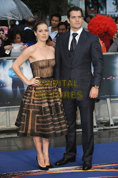 Amy Adams, Henry Cavill<br /> 'Man Of Steel' UK film premiere, Empire cinema, Leicester Square, London, England.<br /> 12th June 2013<br /> full length beige black strapless dress pattern alice band brown lace grey gray suit hand on hip<br /> CAP/BEL<br /> &copy;Tom Belcher/Capital Pictures