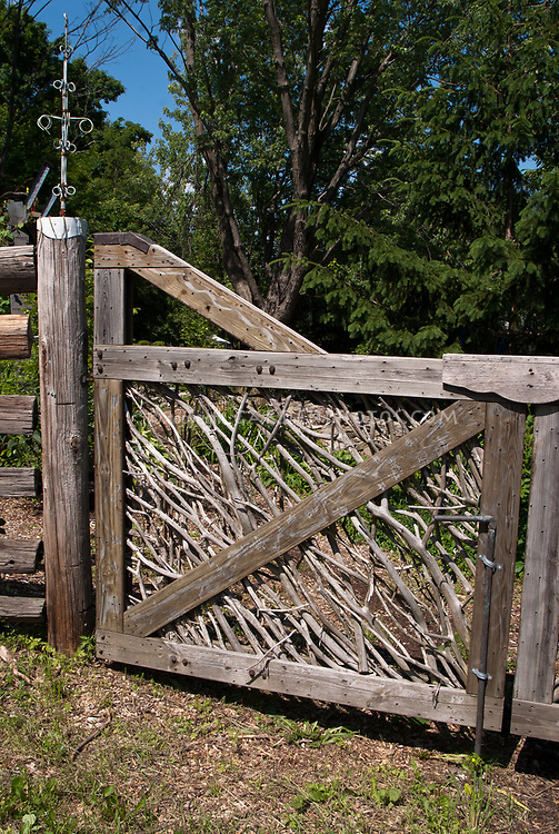 Dress Up A Wooden Fence With Fancy Gate To The Backyard Made From Rustic Natural