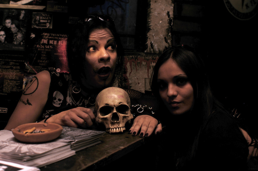 """A couple pose with a fake human skull. """"Darkies"""" or """"Goths"""" at club Uta in the historic center of Mexico City. August 28"""
