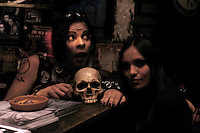 "A couple pose with a fake human skull. ""Darkies"" or ""Goths"" at club Uta in the historic center of Mexico City. August 28"