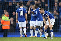 Tom Cleverley looks dejected at the final whistle in the Barclays Premier League match between Everton and Swansea City played at Goodison Park, Liverpool