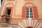 Decorated facade of a building in downtown Como, Italy a town on Lake Como