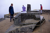 "Machu Picchu, Peru. Inca Intihuatana ""Hitching Post of the Sun"" observatory carved from natural stone with tourists."