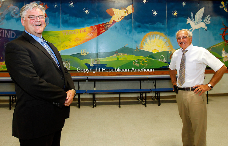 Winsted, CT- 01, August 2011-080111CM03  Tom Danehy, the new superintendent of the Winsted, chats with Blaise A. Salerno Monday afternoon at the Batcheller School.  Danehy will be replacing Salerno,  for the 2011 new school year.  Christopher Massa Republican-American