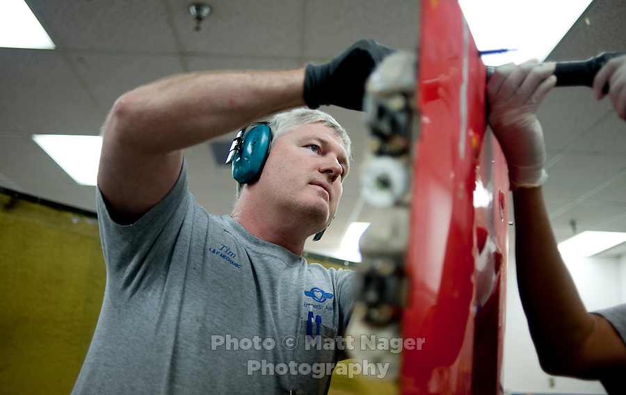 Timothy Regnold (cq) replaces a worn rub strip on an engine cowling in the maintenance facility of Southwest Airlines facilities near Love Field Airport in Dallas, Texas, Wednesday, October 27, 2010...PHOTO/ MATT NAGER
