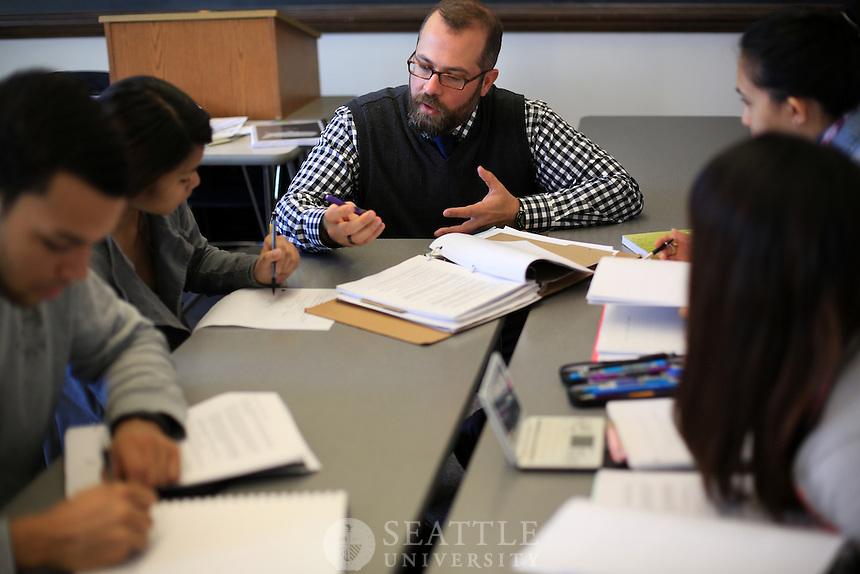 01162013-  Professor Brendan Busse S.J., center, team teaches with Michael Matriotti in Matriotti's Poverty in America class.