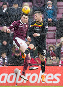 17th March 2018, Tynecastle Park, Edinburgh, Scotland; Scottish Premier League football, Heart of Midlothian versus Partick Thistle;  Jon Souttar of Hearts and Miles Storey of Partick Thistle challenge for the ball