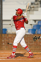 Edgar Lara #27 of the Johnson City Cardinals follows through on his swing versus the Burlington Royals at Howard Johnson Stadium June 27, 2009 in Johnson City, Tennessee. (Photo by Brian Westerholt / Four Seam Images)