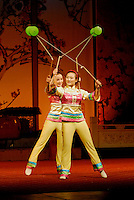 Acrobatic performers juggle spools on strings at Sichuan Opera, Chengdu, China.