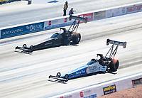 Nov 3, 2019; Las Vegas, NV, USA; NHRA top fuel driver Clay Millican (near) alongside Mike Salinas during the Dodge Nationals at The Strip at Las Vegas Motor Speedway. Mandatory Credit: Mark J. Rebilas-USA TODAY Sports