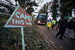 © Joel Goodman - 07973 332324 . No syndication permitted . 27/11/2013 . Manchester , UK . Protesters in front of lorries leaving the site . Energy firm IGas have today (Wednesday 27th November 2013) been receiving drilling equipment in readiness for exploratory drilling at the site . Anti fracking protesters have established a camp at Barton Moss in Greater Manchester alongside an access road leading to an IGas drilling site .  Photo credit : Joel Goodman