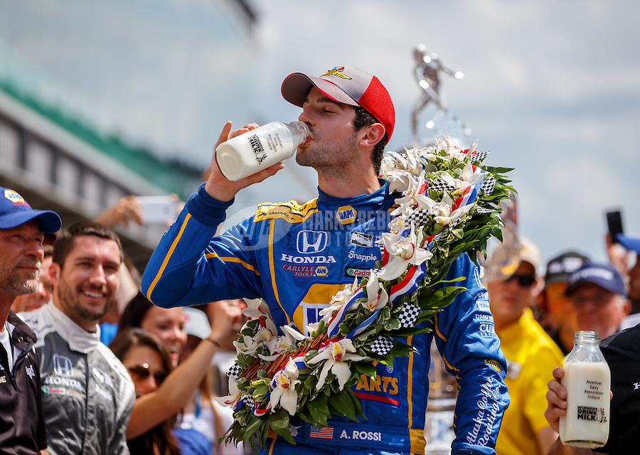 May 29, 2016; Indianapolis, IN, USA; IndyCar Series driver Alexander Rossi drinks milk as he celebrates after winning the 100th running of the Indianapolis 500 at Indianapolis Motor Speedway. Mandatory Credit: Mark J. Rebilas-USA TODAY Sports