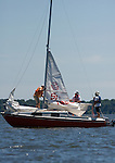 062410tvmainsailfolds.The instructor and students fold down the mainsail as they approach the dock and switch to a motor..BND/TIM VIZER