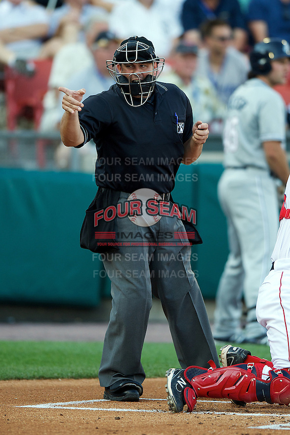Home plate umpire Mark Lollo makes a call during the Triple-A All-Star game featuring the Pacific Coast League and International League top players at Coca-Cola Field on July 11, 2012 in Buffalo, New York.  PCL defeated the IL 3-0.  (Mike Janes/Four Seam Images)