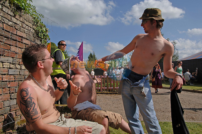 04-06-06 Garden Party Music Festival held in Ballinlough Castle, County Meath..Music fans sun themselves at the above..Photo:Barry Cronin/Newsfile<br />