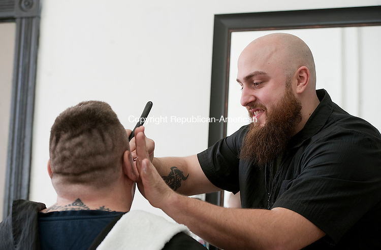 TORRINGTON,  CT-121616JS03 --Dale Becker, owner of Date's Barber Shop on Water Street in Torrington, shaves a customer at his new shop on Friday. <br /> Jim Shannon Republican American