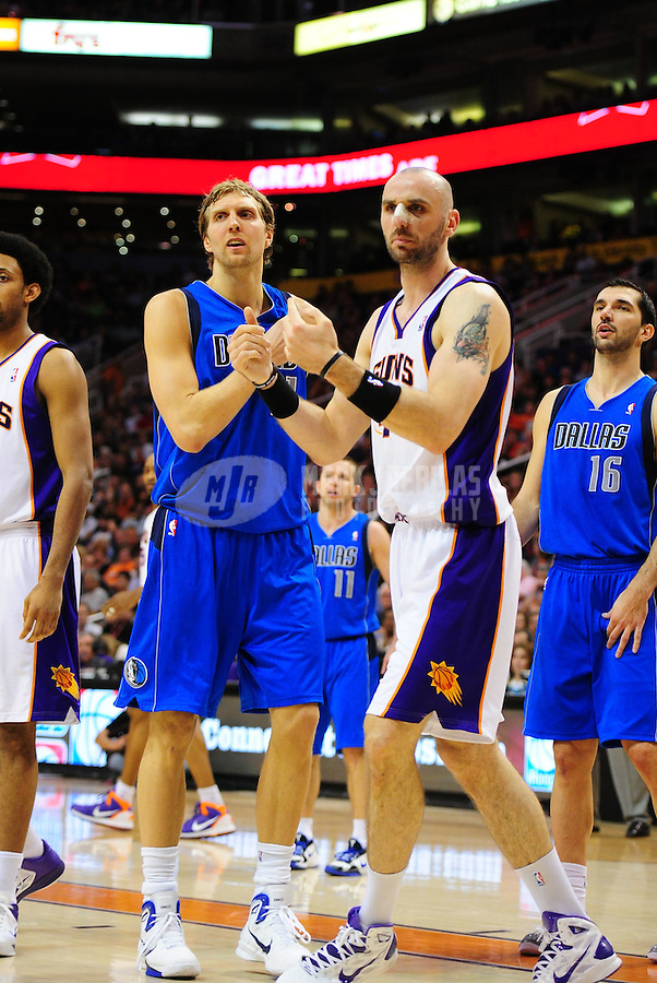 Mar. 27, 2011; Phoenix, AZ, USA; Dallas Mavericks forward (41) Dirk Nowitzki and Phoenix Suns forward (4) Marcin Gortat at the US Airways Center. The Maverick defeated the Suns 91-83. Mandatory Credit: Mark J. Rebilas-