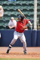 Birmingham Barons infielder Christian Marrero (24) at bat during a game against the Biloxi Shuckers on May 24, 2015 at Joe Davis Stadium in Huntsville, Alabama.  Birmingham defeated Biloxi 6-4 as the Shuckers are playing all games on the road, or neutral sites like their former home in Huntsville, until the teams new stadium is completed.  (Mike Janes/Four Seam Images)