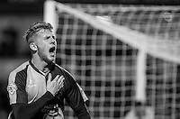 Jason McCarthy of Wycombe Wanderers holds the club badge as he celebrates scoring the winning goal during the Sky Bet League 2 match between Wycombe Wanderers and Oxford United at Adams Park, High Wycombe, England on 19 December 2015. Photo by Andy Rowland.