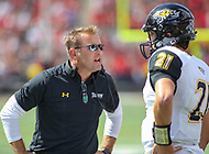 College Park, MD - September 9, 2017: Towson Tigers head coach Rob Ambrose talks to Towson Tigers quarterback Ryan Stover (21) during game between Towson and Maryland at  Capital One Field at Maryland Stadium in College Park, MD.  (Photo by Elliott Brown/Media Images International)