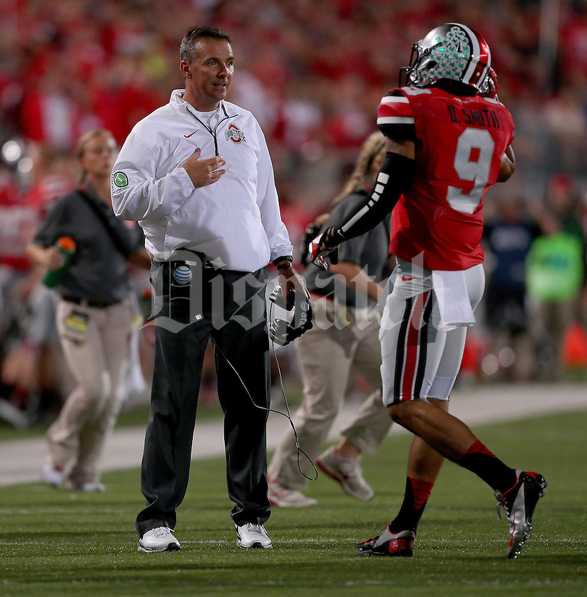 Ohio State Buckeyes head coach Urban Meyer talks to Ohio State Buckeyes wide receiver Devin Smith (9) during the second half of the game between Ohio State and Wisconsin at Ohio Stadium on Saturday, September 28, 2013. (Columbus Dispatch photo by Jonathan Quilter)