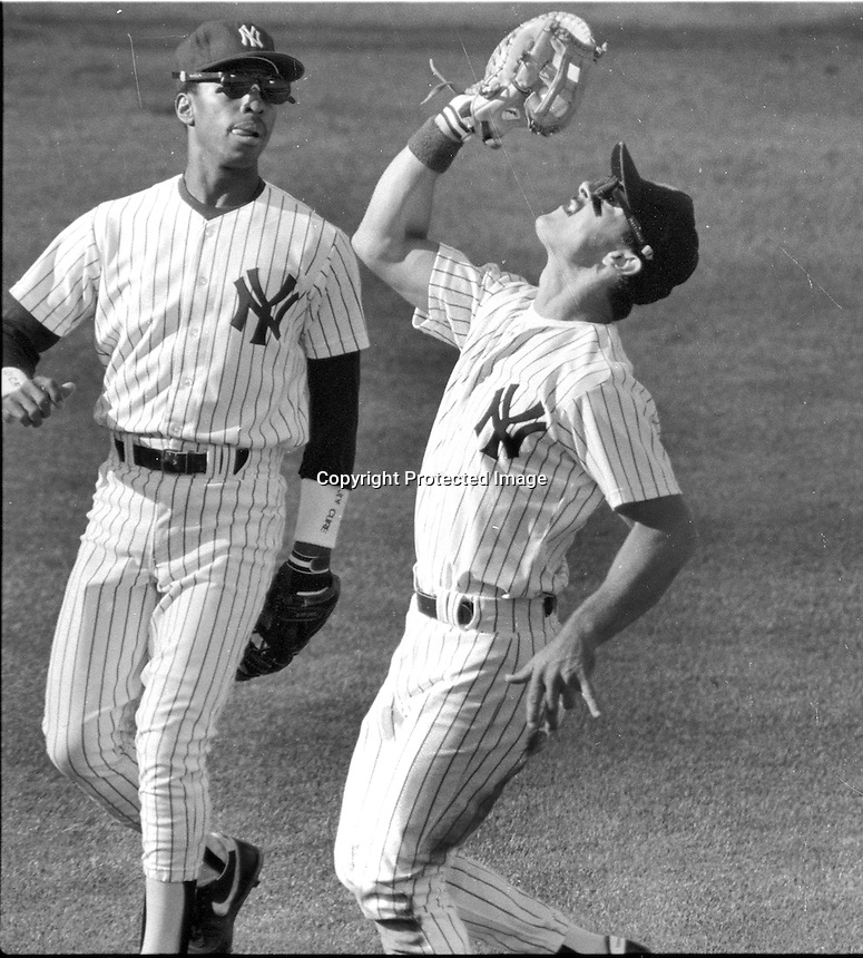 New York Yankee Don Mattingly catches pop up along side Willie Randolph during All-star game 1987. (Photo/Ron Riesterer)