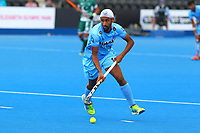 India's Mandeep Singh in action during the Hockey World League Semi-Final 5-8th place match between Pakistan and India at the Olympic Park, London, England on 24 June 2017. Photo by Steve McCarthy.
