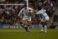 Twickenham. GREAT BRITAIN,  Pat SANDERSON, running with the ball, Puma's Jose Maria Nunez Piossek, checks his run, during the, 2006 Investec Challenge, game between, England  and Argentina, on Sat., 11/11/2006, played at the Twickenham Stadium, England. Photo, Peter Spurrier/Intersport-images].....